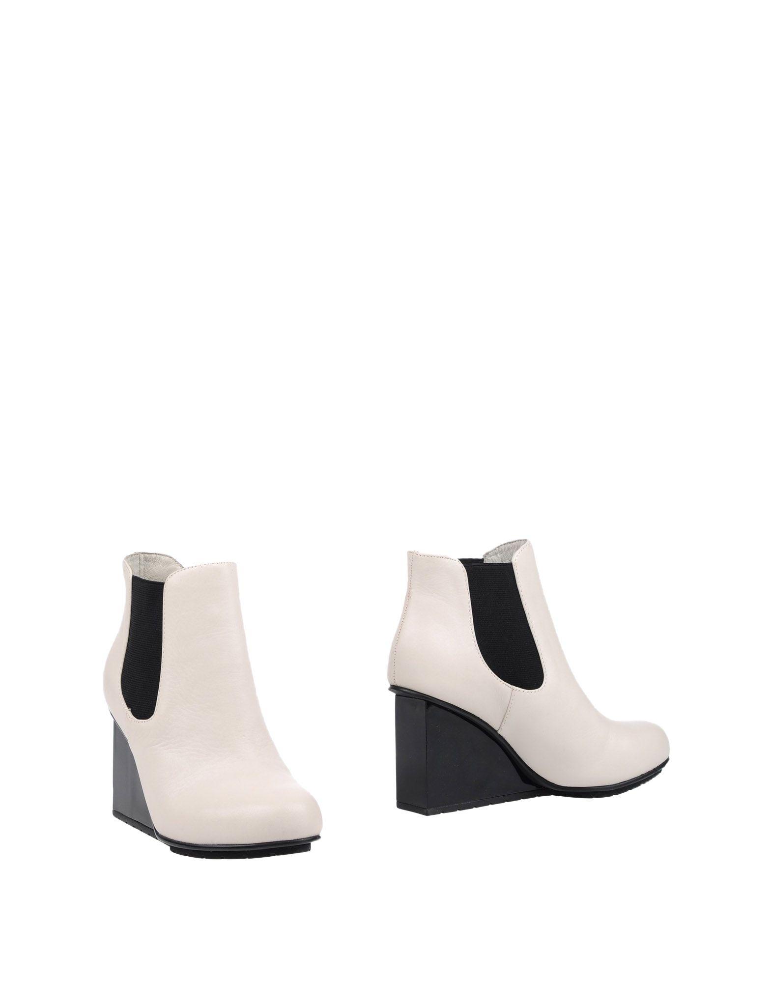 где купить UNITED NUDE Полусапоги и высокие ботинки по лучшей цене