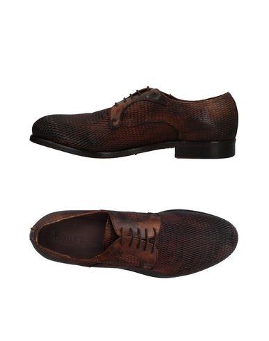 Фото - Обувь на шнурках коричневого цвета