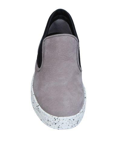 Фото 2 - Низкие кеды и кроссовки от HOGAN REBEL серого цвета