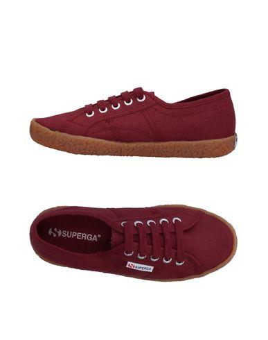Купить Низкие кеды и кроссовки от SUPERGA красно-коричневого цвета