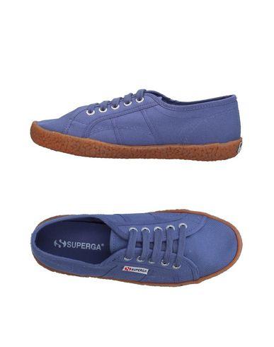 Купить Низкие кеды и кроссовки от SUPERGA светло-фиолетового цвета
