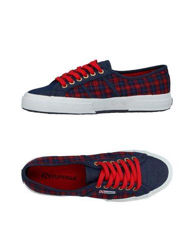 Купить Низкие кеды и кроссовки от SUPERGA темно-синего цвета