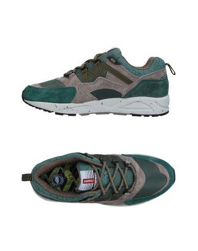 Фото - Низкие кеды и кроссовки от KARHU зеленого цвета