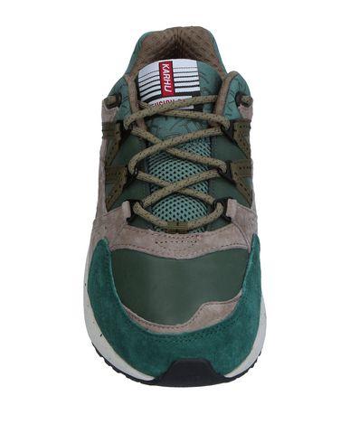 Фото 2 - Низкие кеды и кроссовки от KARHU зеленого цвета