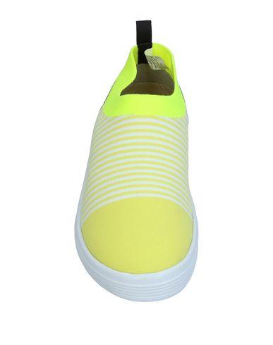 Фото 2 - Низкие кеды и кроссовки от ADNO® желтого цвета