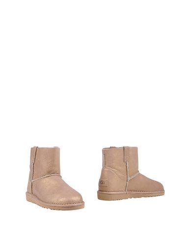 Купить Полусапоги и высокие ботинки золотистого цвета