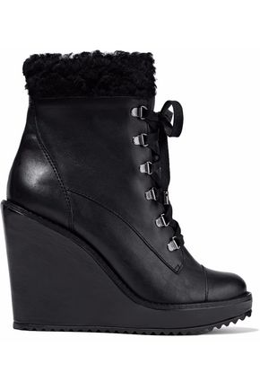 SCHUTZ Faux fur-trimmed leather wedge ankle boots