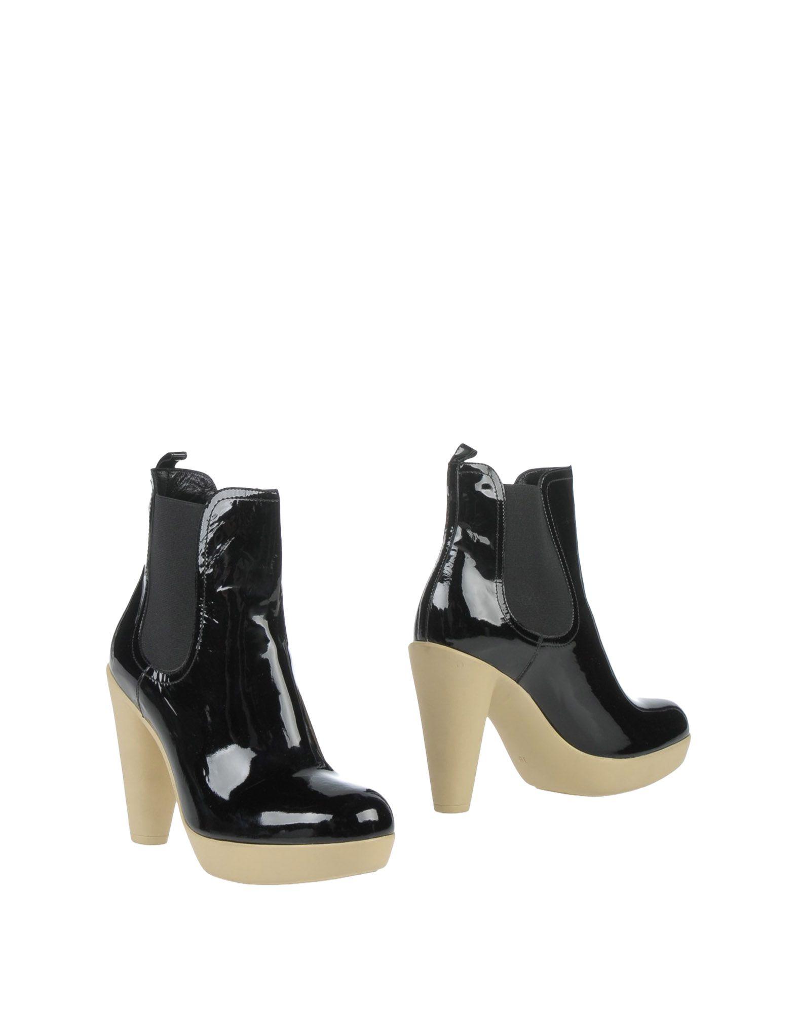 где купить LANVIN Полусапоги и высокие ботинки по лучшей цене