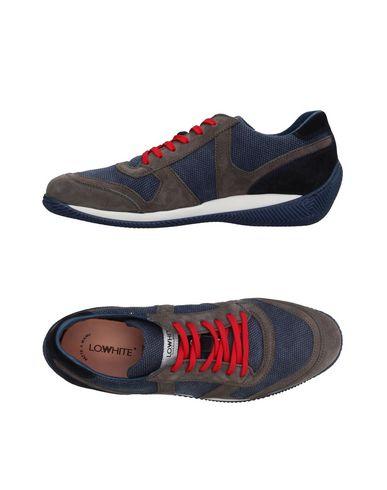 Купить Низкие кеды и кроссовки от LO.WHITE серого цвета