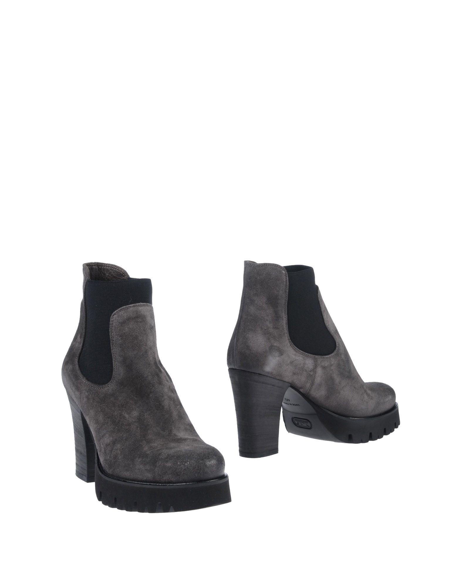 купить NOW Полусапоги и высокие ботинки дешево