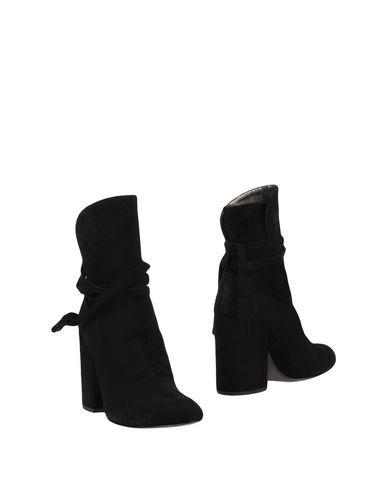 Полусапоги и высокие ботинки от ANN TUIL
