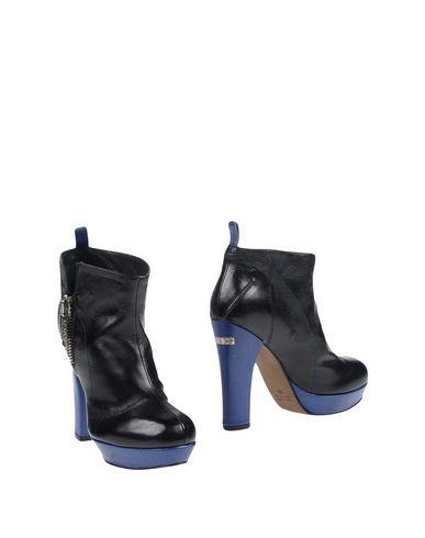 zapatillas C N C COSTUME NATIONAL Botines de ca?a alta mujer