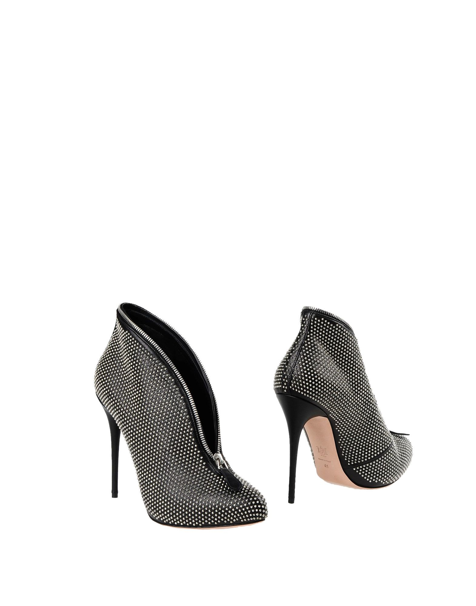ALEXANDER MCQUEEN Booties. solid color, spike heel, leather sole, round toeline, leather lining, studs, zip, contains non-textile parts of animal origin. Leather