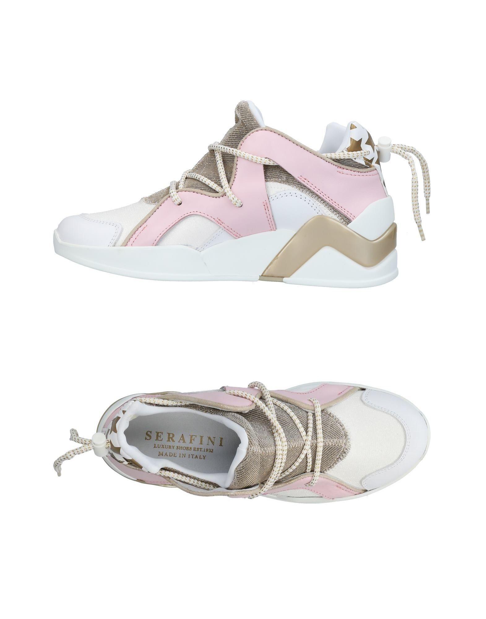 SERAFINI LUXURY Низкие кеды и кроссовки luxury stand flip