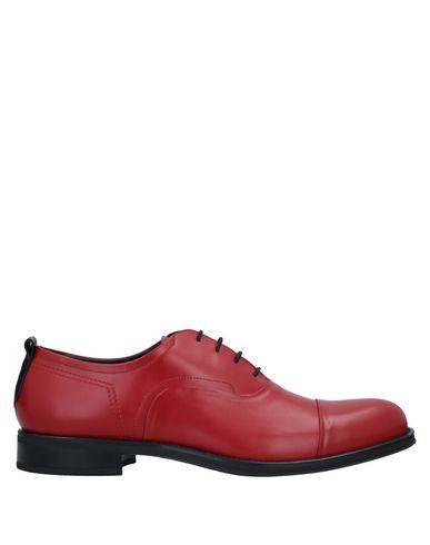 Фото - Обувь на шнурках красного цвета