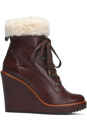 SCHUTZ Leather and faux shearling wedge ankle boot