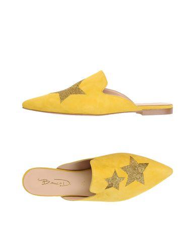 Купить Мюлес и сабо от BIANCA DI желтого цвета