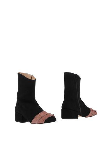 Полусапоги и высокие ботинки от RACINE CARRÉE