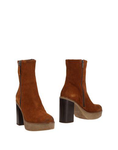 Полусапоги и высокие ботинки от GRANDINETTI