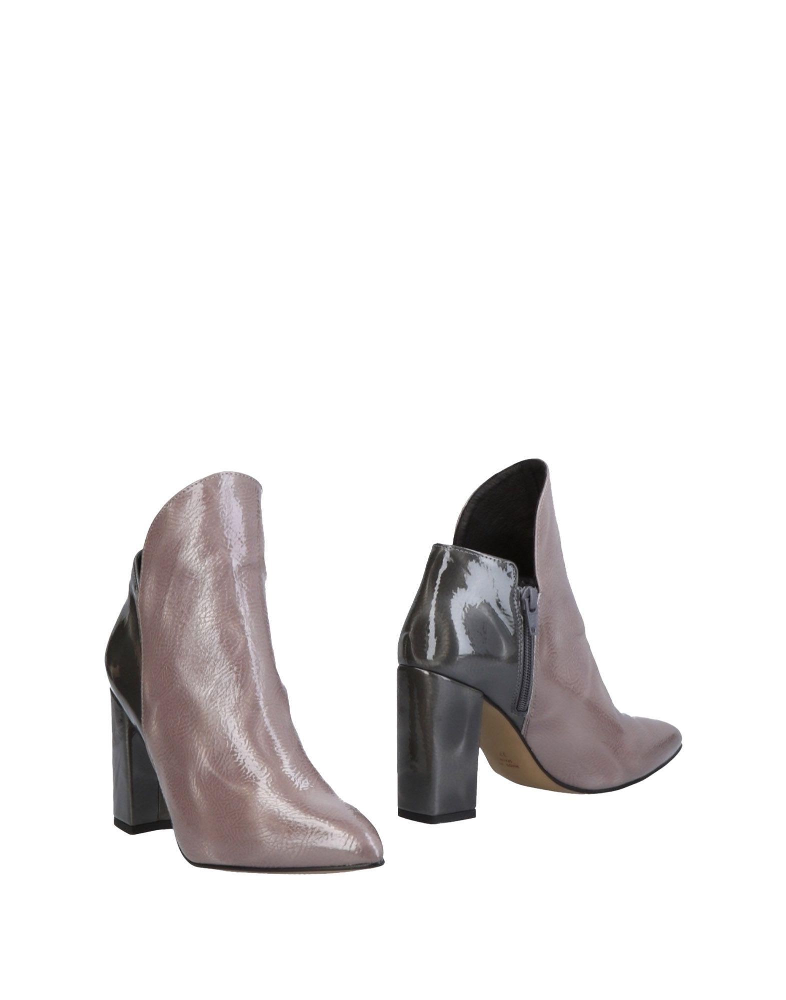 STIÙ Полусапоги и высокие ботинки stiù мюлес и сабо