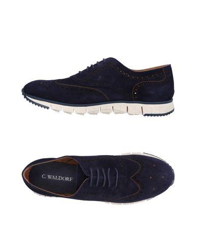 Фото - Низкие кеды и кроссовки от C.WALDORF темно-синего цвета