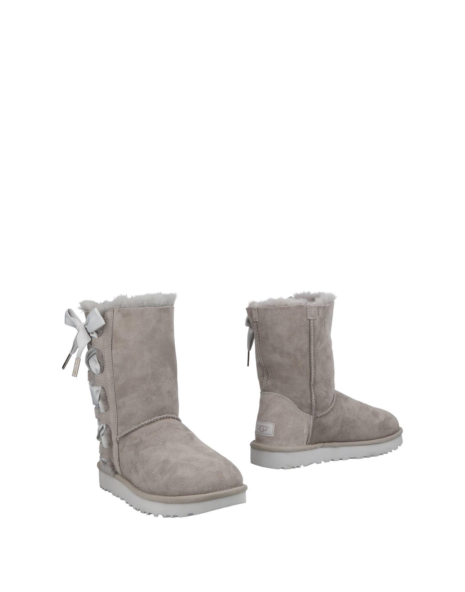 купить UGG AUSTRALIA Полусапоги и высокие ботинки по цене 16500 рублей