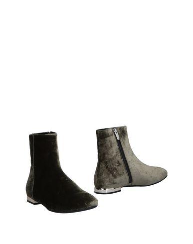 Полусапоги и высокие ботинки от 18 KT