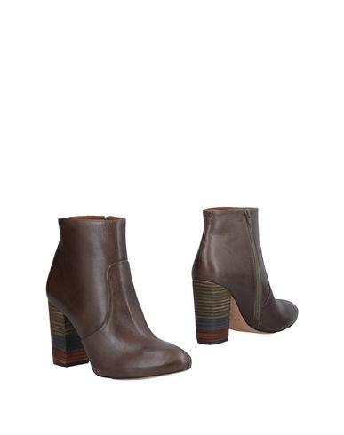 Полусапоги и высокие ботинки от CUOIERIA