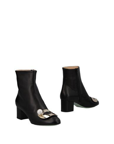 Полусапоги и высокие ботинки от GIANNICO