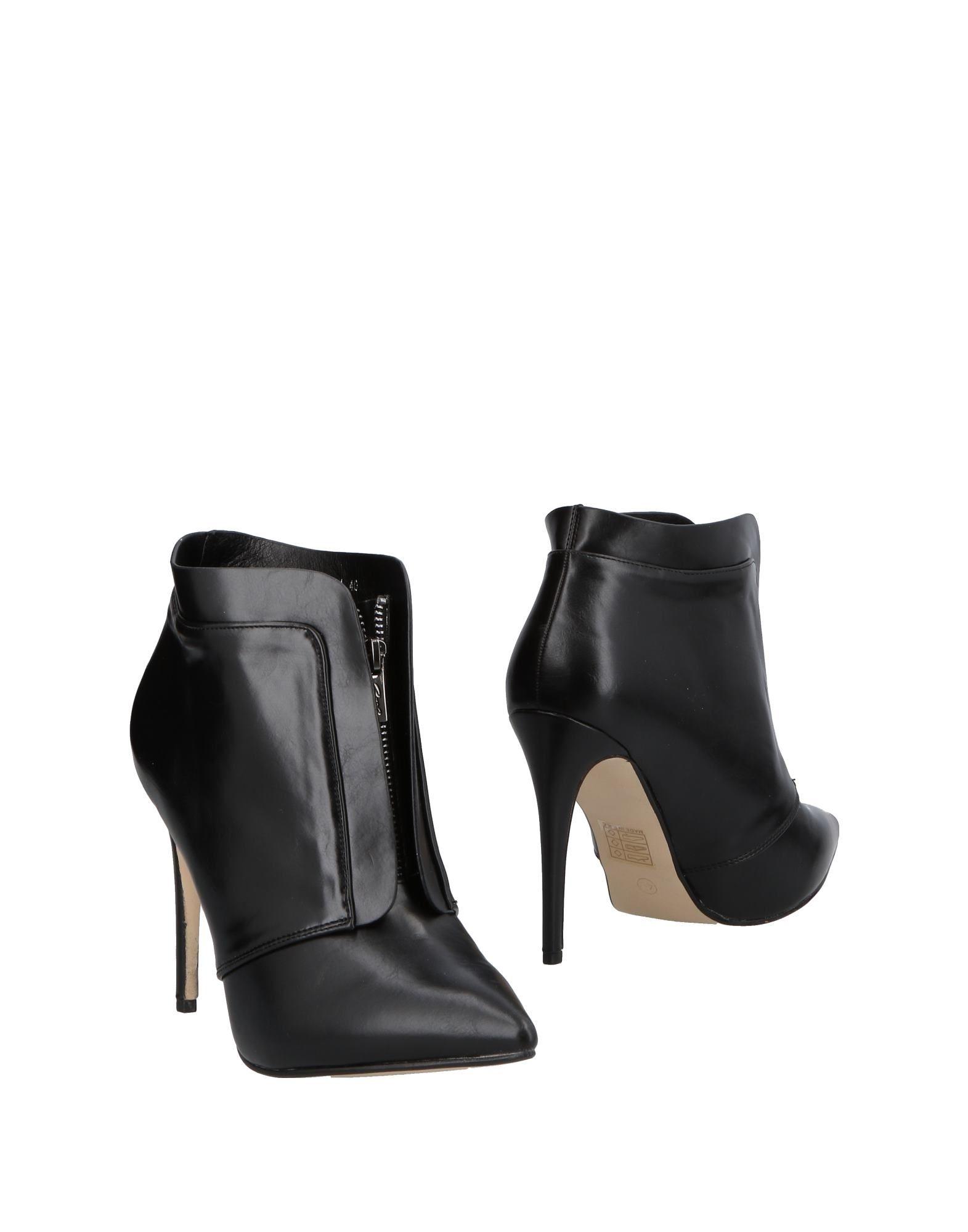 AXEL Полусапоги и высокие ботинки