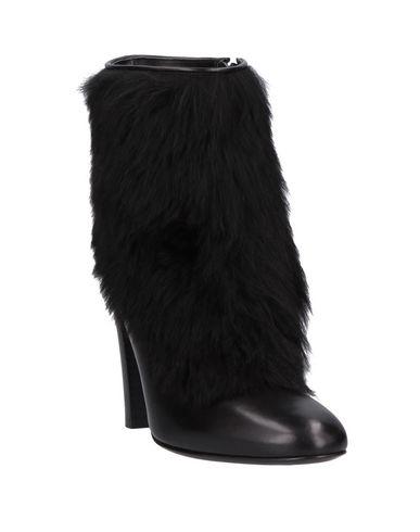 Фото 2 - Полусапоги и высокие ботинки от MICHEL VIVIEN черного цвета
