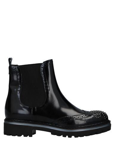 Полусапоги и высокие ботинки от ALAN JURNO