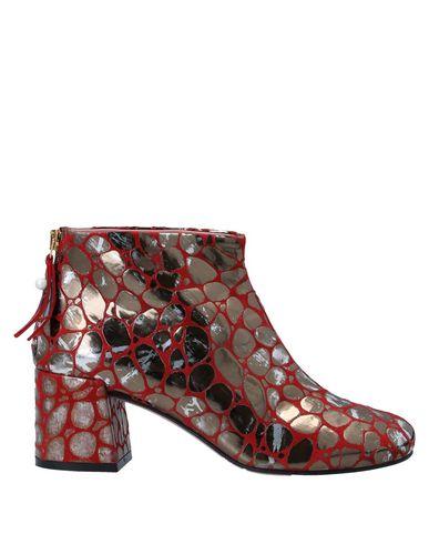 Фото - Полусапоги и высокие ботинки от TIPE E TACCHI красного цвета