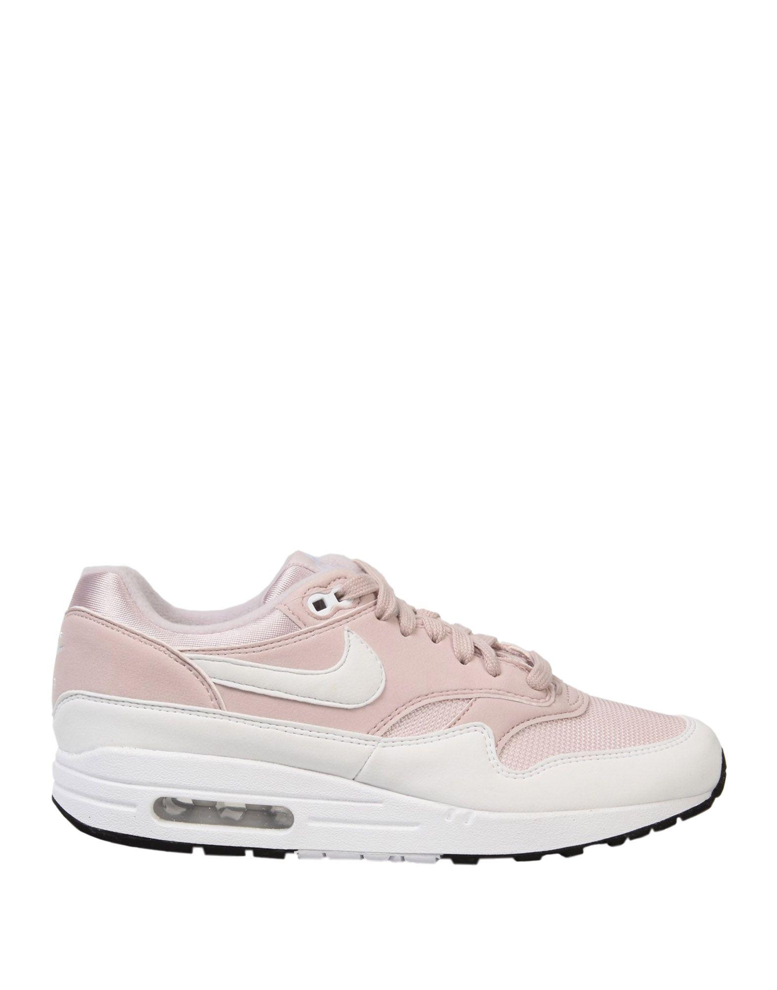 NIKE Низкие кеды и кроссовки кроссовки для девочки nike air max motion lw цвет черный 917654 001 размер 5y 36 5