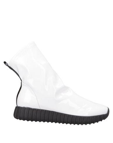 Высокие кеды и кроссовки от LE PEPITE