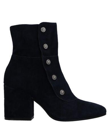 Полусапоги и высокие ботинки от CHOCOLÀ