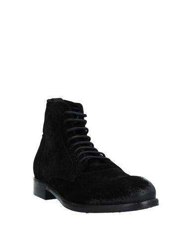 Фото 2 - Полусапоги и высокие ботинки от LE QARANT черного цвета