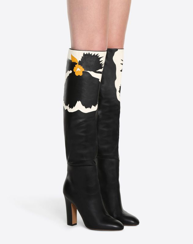 Boot with flower inlay