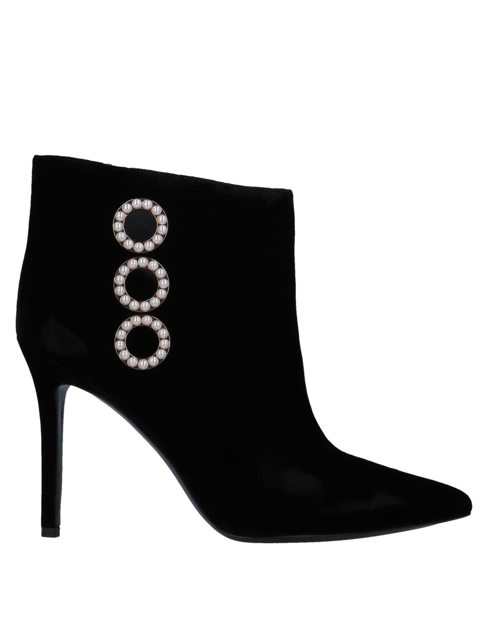купить STELLA LUNA Полусапоги и высокие ботинки по цене 16800 рублей