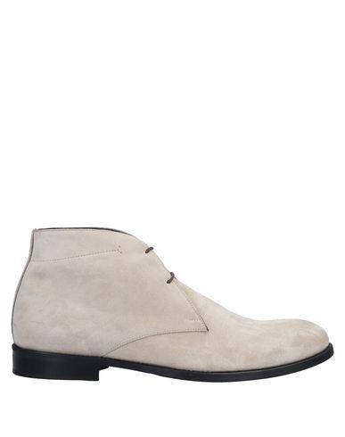 Полусапоги и высокие ботинки от ALEXANDER