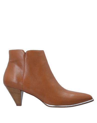 Купить Полусапоги и высокие ботинки от OASI желто-коричневого цвета