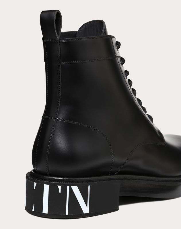 VLTN BRUSH-OFF CALFSKIN COMBAT BOOTS