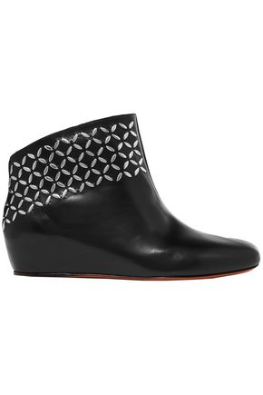 ALAÏA Studded leather wedge ankle boots