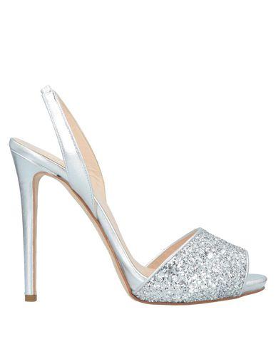 Фото - Женские сандали  серебристого цвета