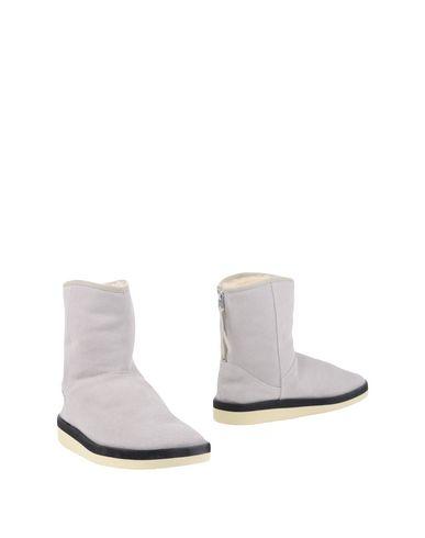 Полусапоги и высокие ботинки Suicoke