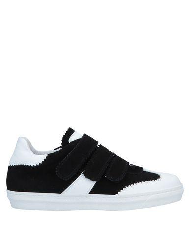 Купить Низкие кеды и кроссовки от CARLA G. черного цвета
