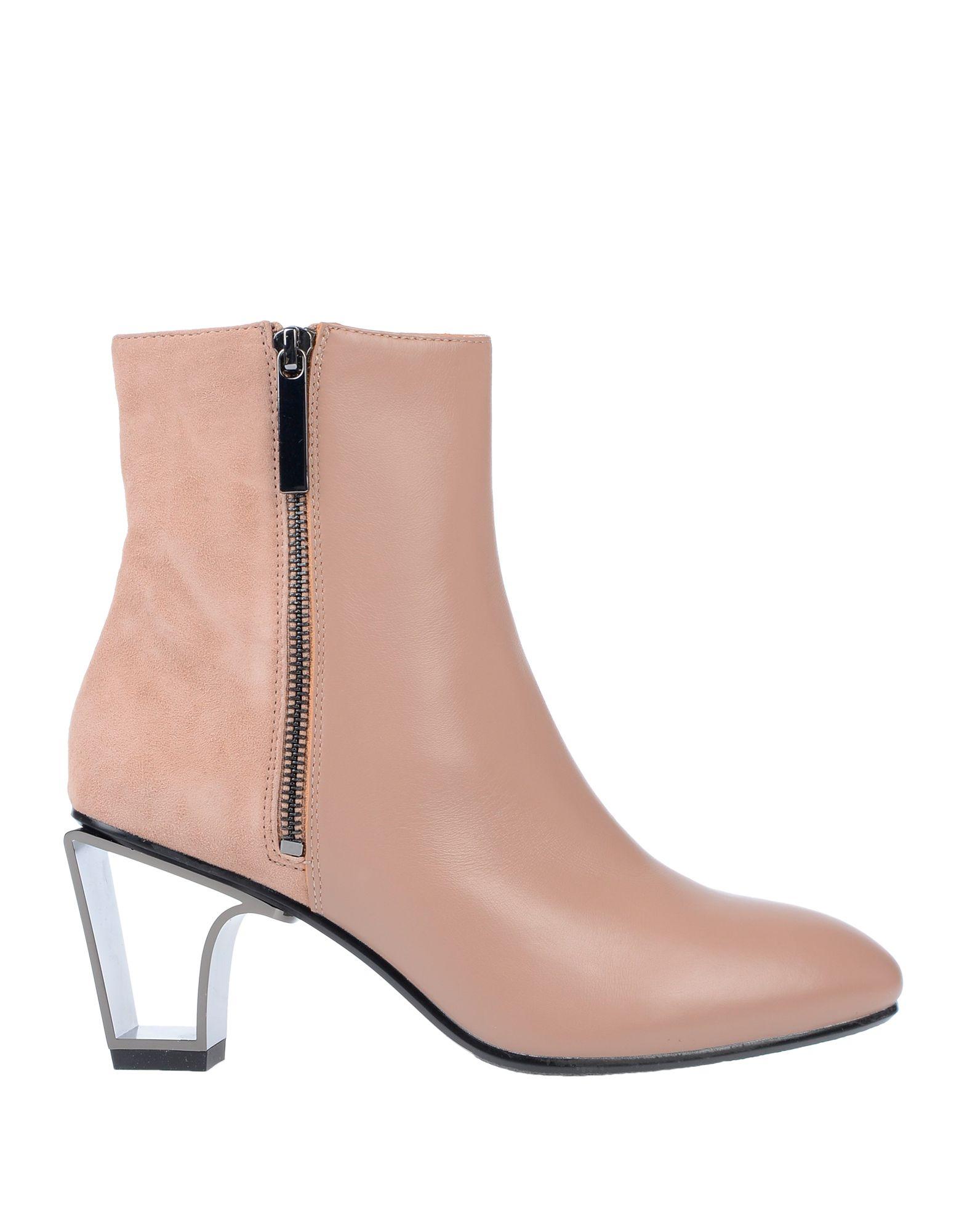 купить UNITED NUDE Полусапоги и высокие ботинки по цене 16000 рублей
