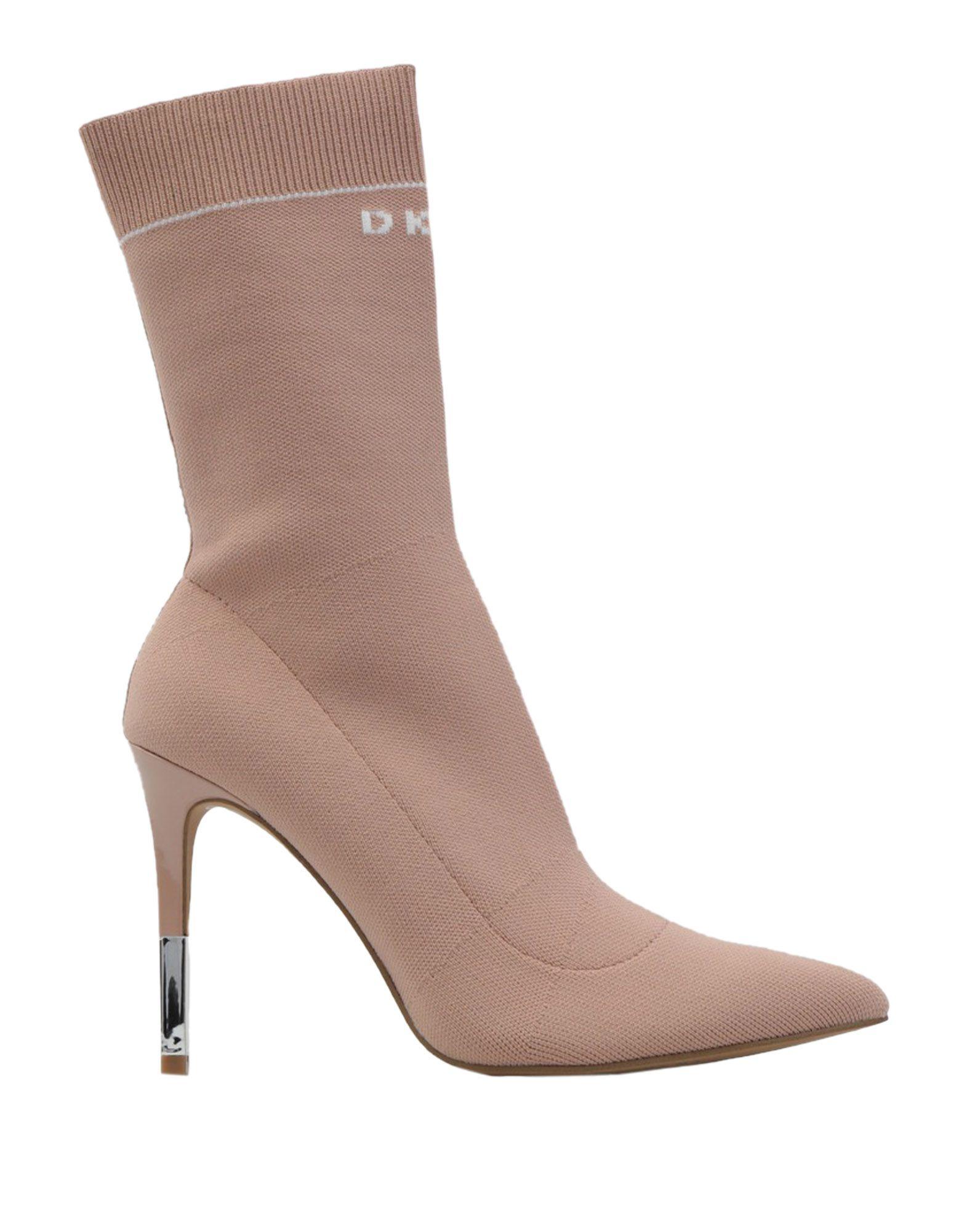 Фото - DKNY Полусапоги и высокие ботинки обувь на высокой платформе dkny