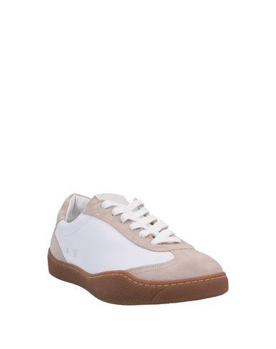 Фото 2 - Низкие кеды и кроссовки бежевого цвета
