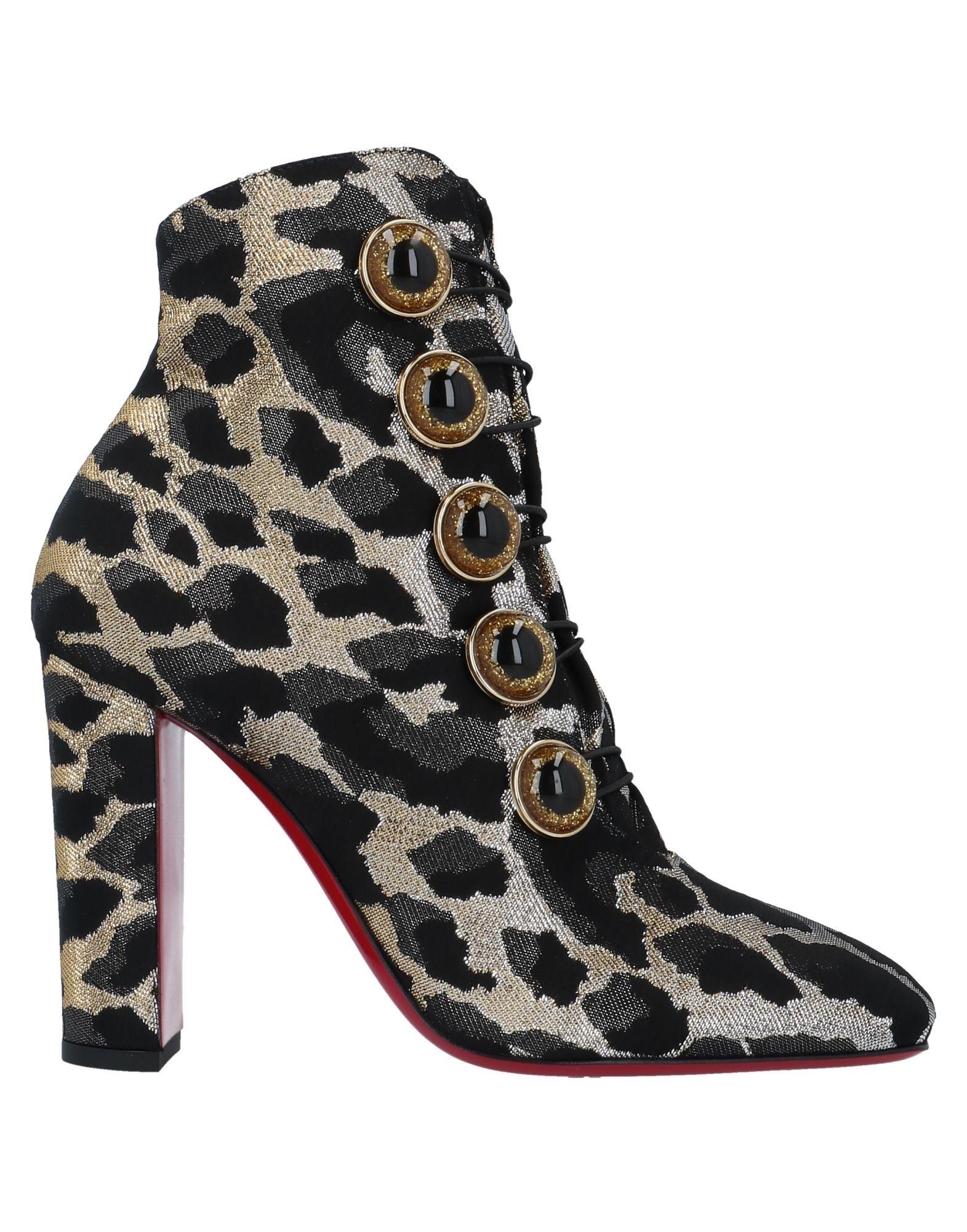 купить CHRISTIAN LOUBOUTIN Полусапоги и высокие ботинки по цене 34000 рублей